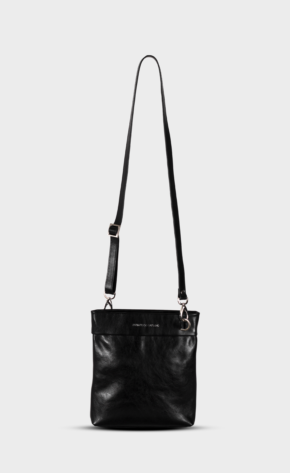 Black leather crossbody with polished zippers. Crossbody is lined.