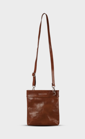 Brown leather crossbody with polished zippers. Crossbody is lined.