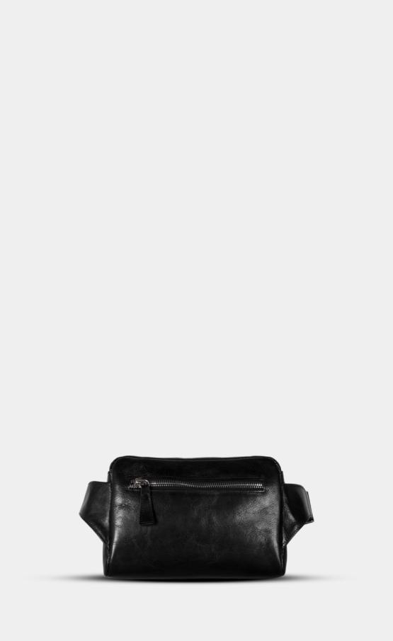 Černá kožená ledvinka s leštěným zipem. Ledvinka je vypodšívkovaná. Přední hlavní kapsa a zadní kapsa.