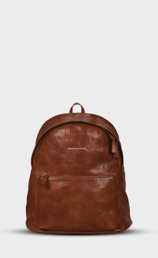 Brown leather backpack with polished zippers. The backpack is lined. Two pockets and one inside.