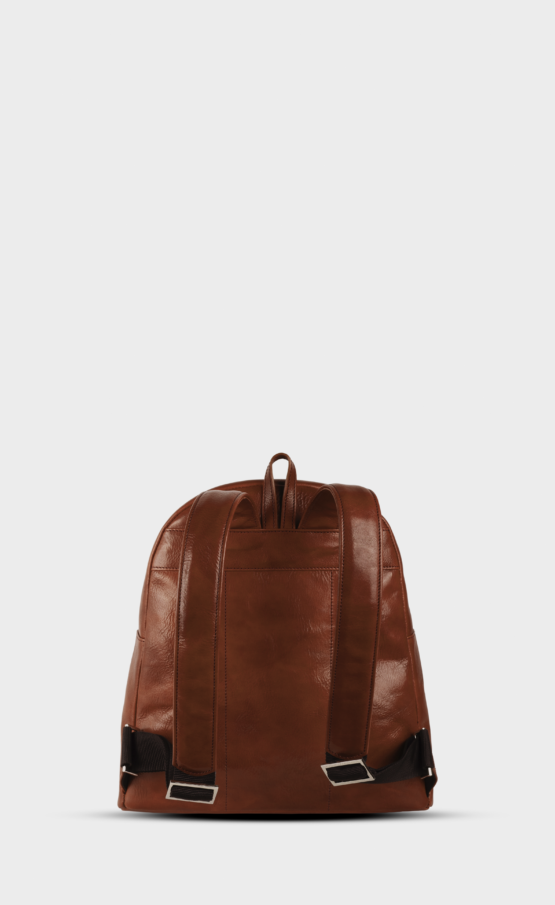 Brown leather backpack mini with polished zippers. The backpack is lined. Two pockets and one inside.